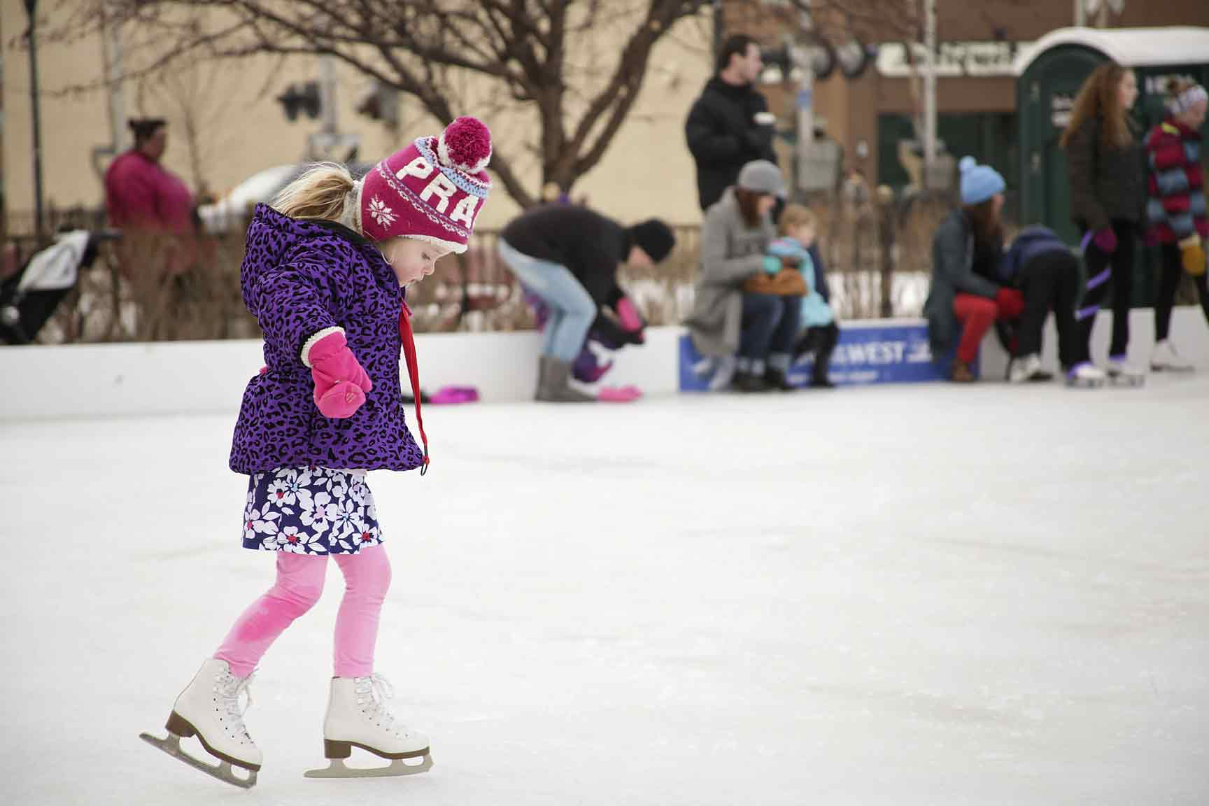Child ice skating in downtown Fargo