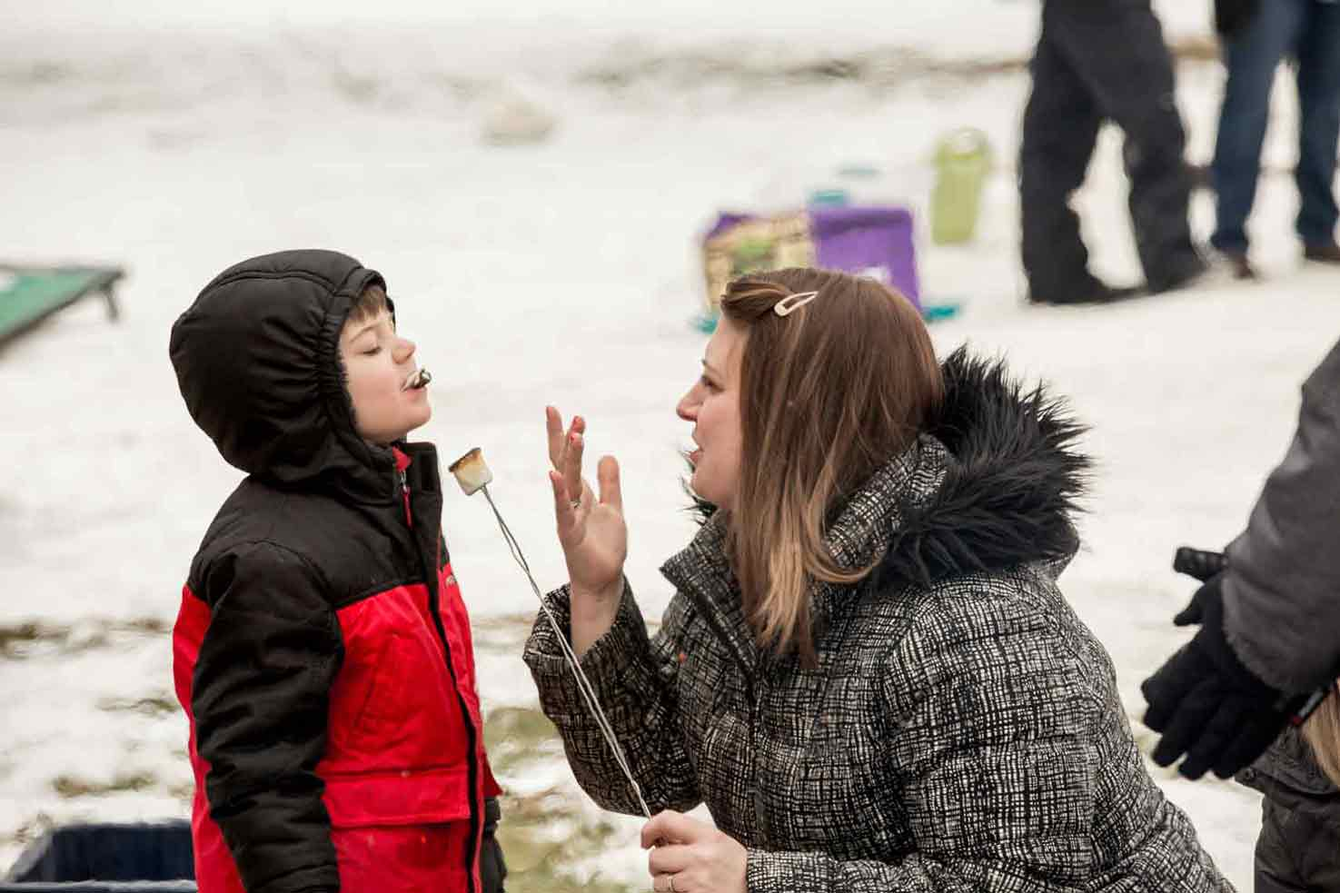 Mother and son eating marshmellows