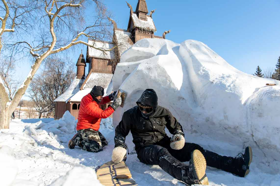 Snow sculptors by Scandinavian Church